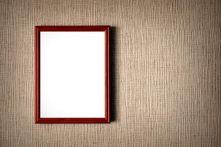 Old wooden photo frame on wall background Standard-Bild