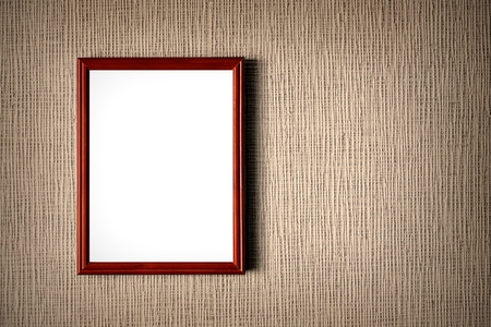 Old wooden photo frame on wall background Stockfoto