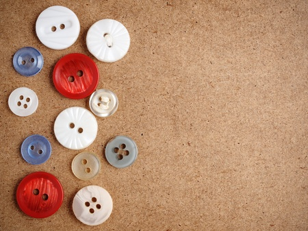 Buttons on cardboard background photo