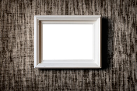 Old wooden picture frame on wall background Stockfoto