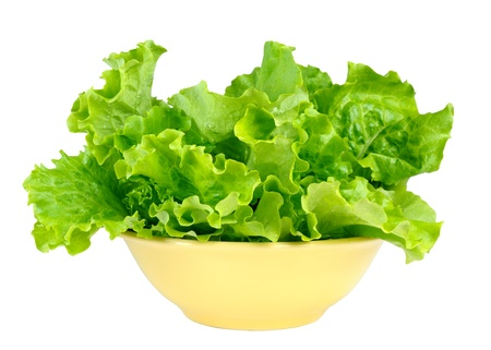 Lettuce leaves in bowl isolated on white background photo