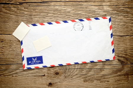 Old envelope on wooden background Stock Photo - 13290800