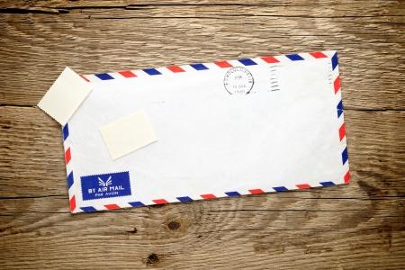 Old envelope on wooden background