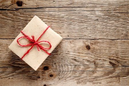 wrapped gift: Vintage gift box on wooden background