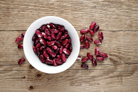 Fabaceae: Beans in bowl on wooden background Stock Photo