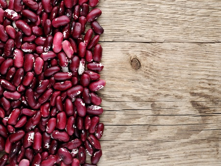 Fabaceae: Beans on wooden background Stock Photo