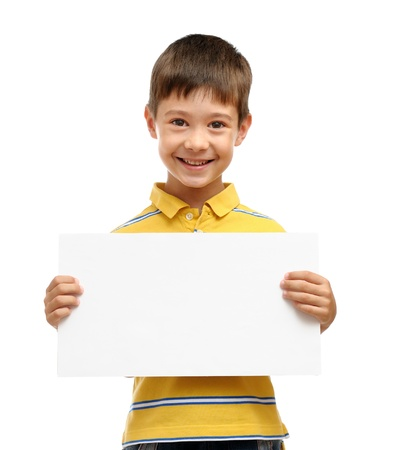 Happy boy holding blank poster isolated on white background Imagens