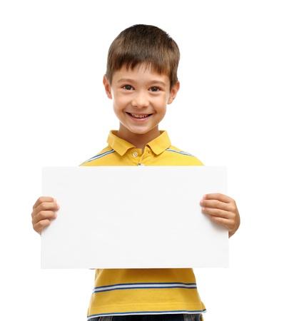 Happy boy holding blank poster isolated on white background Standard-Bild