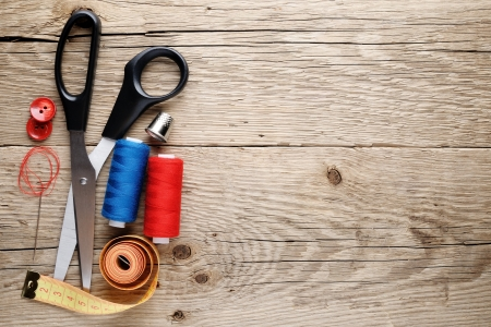 haberdashery: Sewing accessories on wooden background