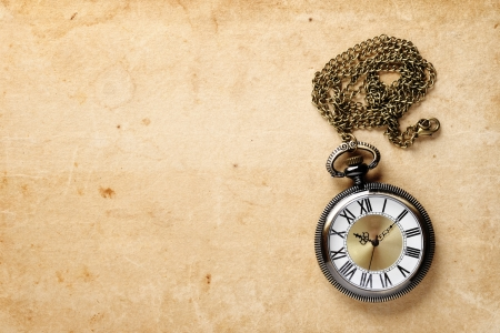 Vintage pocket watch on old paper photo