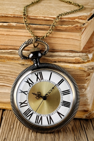 Antique watch and books Standard-Bild