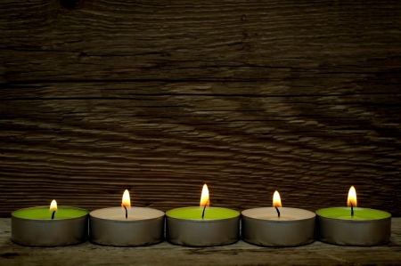 Burning candles on wooden background photo