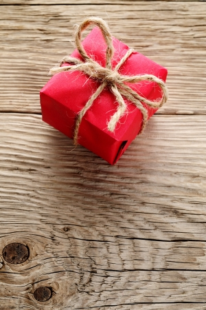 Gift box wrapped in red paper on wooden background Stock Photo - 17755329