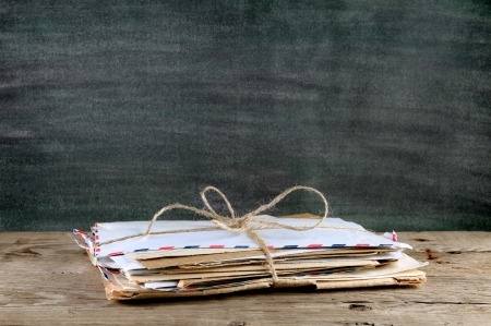 Pile of old envelopes on wooden table
