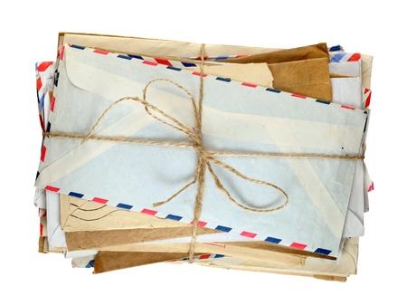 Pile of old envelopes isolated on white background Stockfoto