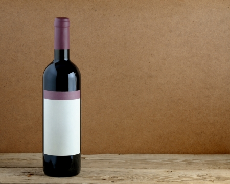 Bottle of wine on wooden table photo