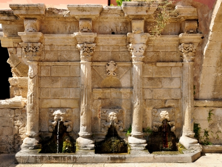 rethymno: Old venetian fountain in city of Rethymno, Crete, Greece Stock Photo