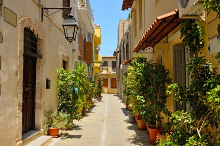 Typical narrow street in city of Rethymno, Crete, Greece photo