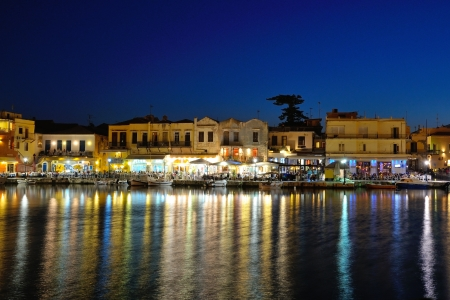 rethymno: Old Venetian harbour in the evening in city of Rethymno, Crete, Greece Stock Photo