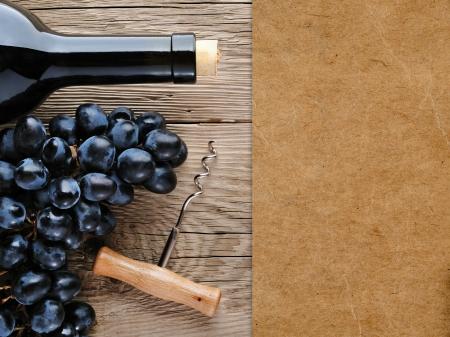 wine cork: Wine bottle, corkscrew and grape on wooden background Stock Photo