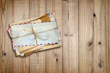 old envelope: Pile of old envelopes on wooden background Stock Photo