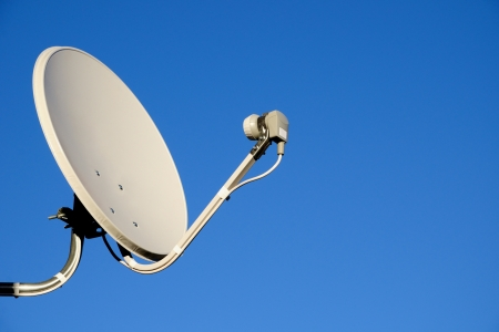 satellite tv: Satellite TV antenna on blue sky background