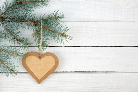 Paper heart and branches of blue spruce on wooden background Stockfoto