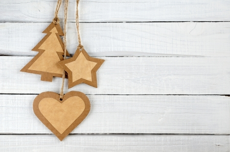 Paper Christmas decorations on wooden background photo