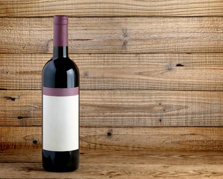 Wine bottle on wooden table