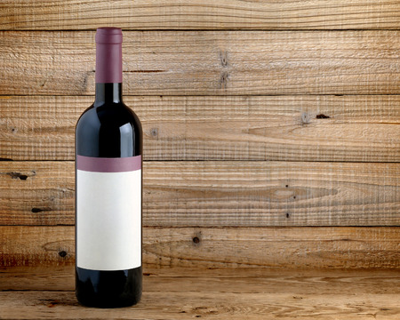 brown bottle: Wine bottle on wooden table