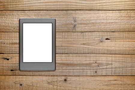 e book reader: E-book reader on wooden table
