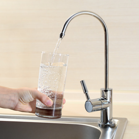 potable: Filling glass of water from kitchen faucet Stock Photo