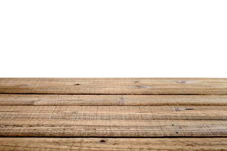 Old wooden table isolated on white background  Shallow depth of field