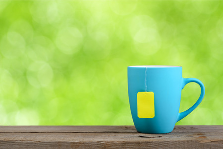 teabag: Cup of tea on green nature background