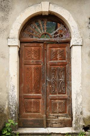 adriatic: Old wooden door in town Prcanj, Montenegro
