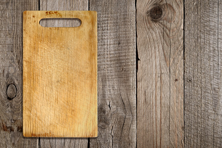 chopping: Chopping board on old wooden background