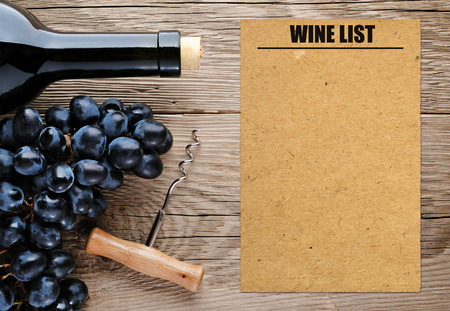 Bottle of wine, corkscrew, grape and blank wine list photo