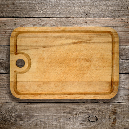 chopping board: Chopping board on old wooden background
