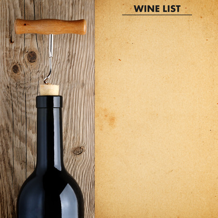 Bottle of wine with corkscrew and wine list 스톡 콘텐츠