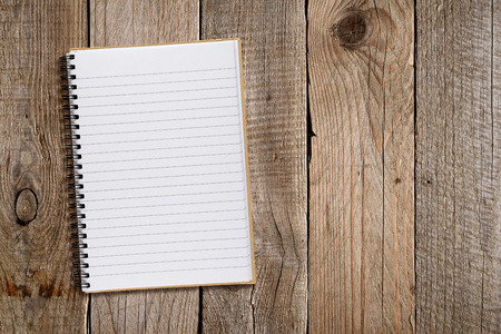 in lined: Lined notepad on old wooden background