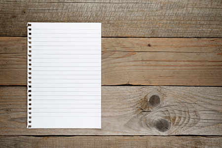 lined: Lined paper on wooden background Stock Photo