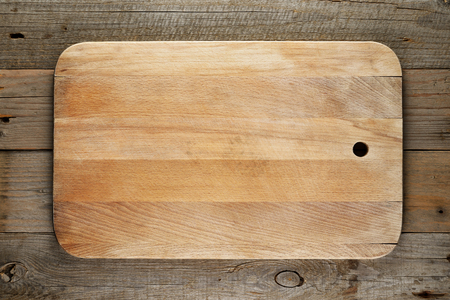 chopping: Chopping board on wooden background Stock Photo