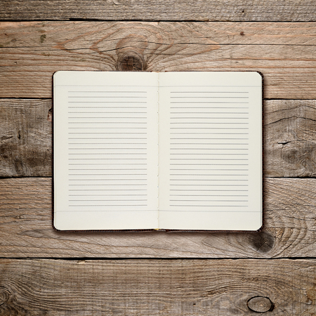 open diary: Open diary on wooden background