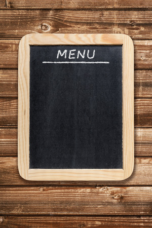 black boards: Menu board on wooden background