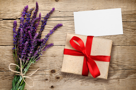 herbal: Flowers of salvia and gift box with visiting card on wooden background