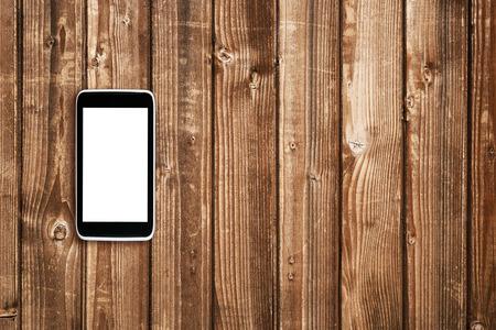 trompo de madera: Teléfono celular en vista superior mesa de madera Foto de archivo