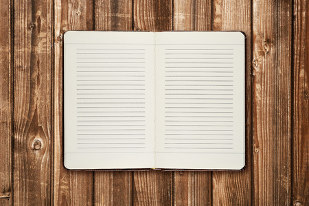 diaries: Diary on wooden table Stock Photo