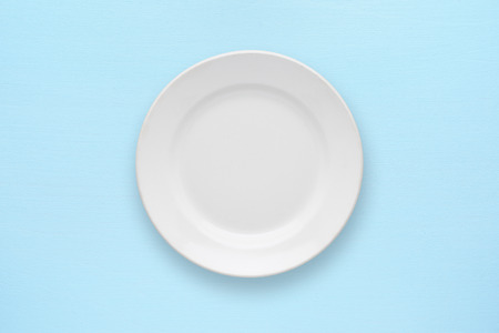 wooden plate: White empty plate top view on table Stock Photo