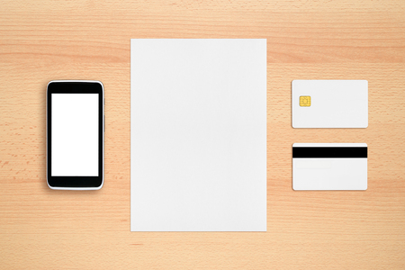 blank page: Credit card, paper sheet and cell phone on office table Stock Photo