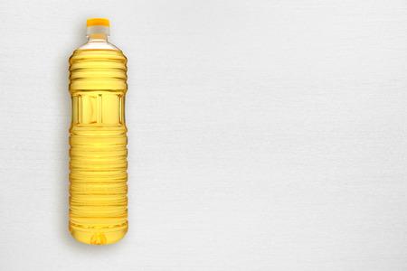 sunflower oil: Bottle of sunflower oil on white table